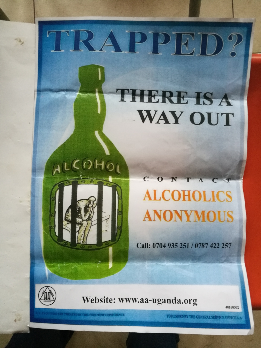 "Image of a poster with a liquor bottle and the text ""Trapped? There is a way out. Contact Alcoholics Anonymous"""